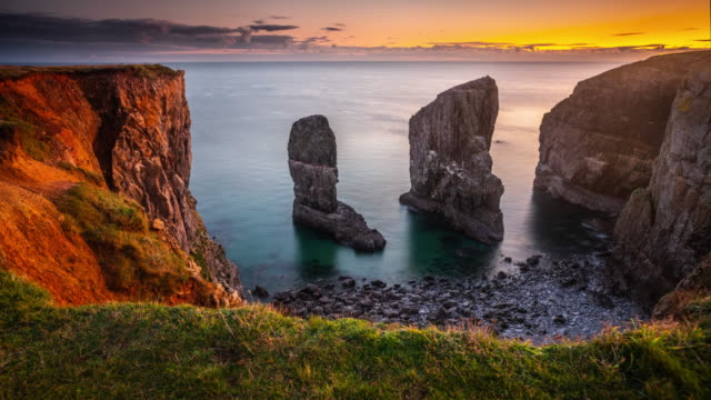 stack rocks in pembrokeshire, wales - tracking shot - extreme terrain stock videos & royalty-free footage