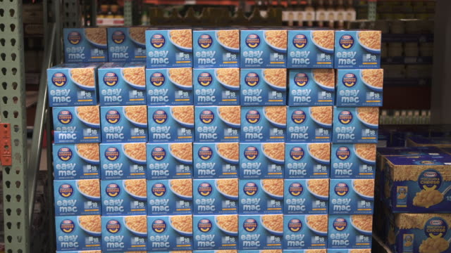 stockvideo's en b-roll-footage met stacked boxes of kraft macaroni cheese sit on a shelf a costco wholesale warehouse usa fkax253n clip taken from programme rushes ablb597x - kraft