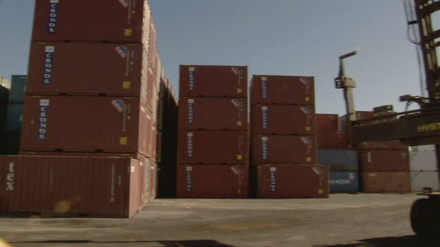 ms stacked cargo containers in container yard/ pan ws man walking over to talk to driver of parked container handler/ sydney, australia - nur männer über 30 stock-videos und b-roll-filmmaterial