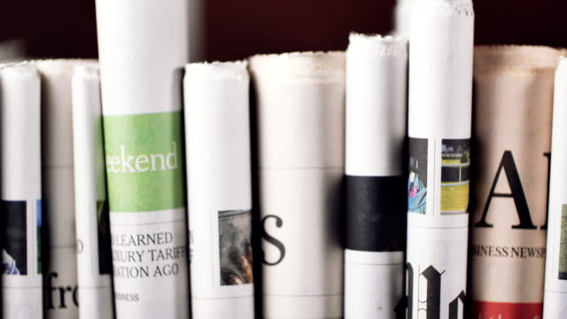 stacked newspaper headlines - folded paper stock videos and b-roll footage