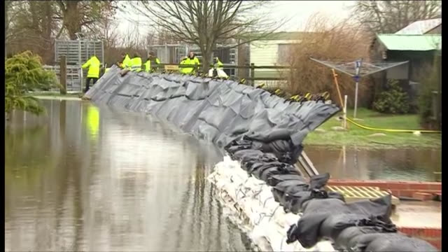 stacked sandbags holding back floodwater in the somerset town of moorland during severe flooding on the somerset levels - sandbag stock videos & royalty-free footage