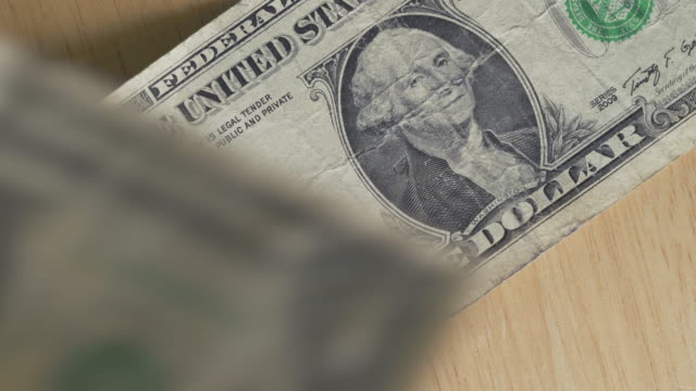 stacking one dollar bills - george washington stock videos and b-roll footage