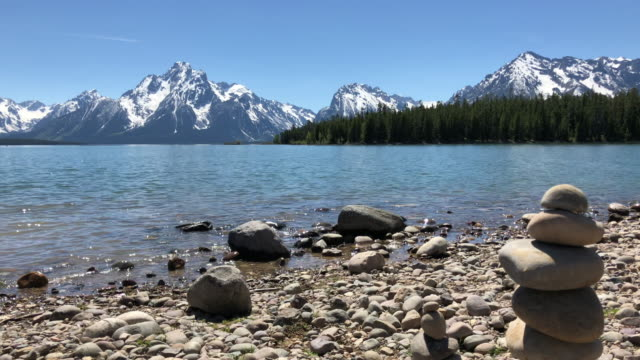 stacking rocks at grand teton national park - grand teton stock videos & royalty-free footage