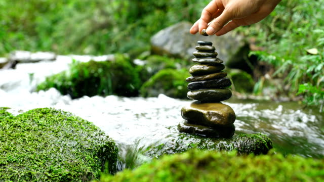 stacking zen stones in nature - pebble stock videos & royalty-free footage