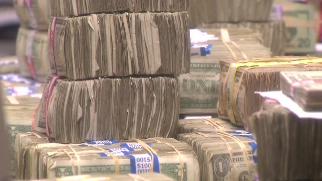 stacks of $1 bills on october 08, 2013 in chicago, illinois - stack stock videos & royalty-free footage