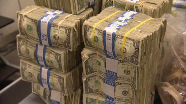 cu tu stacks of 1 dollar bills in bundles of $100 each / kansas city, kansas, united states  - american one dollar bill stock videos & royalty-free footage