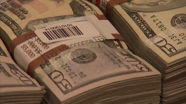 ECU ZO Stacks of 50 dollar bills on table being labeled / Kansas City, Kansas, United States