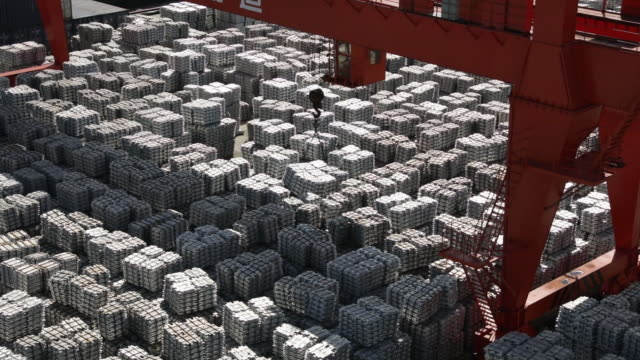 stacks of aluminum ingots sit in a china national materials storage and transportation corporation logistics center in wuxi china on thursday august... - aluminium stock videos & royalty-free footage