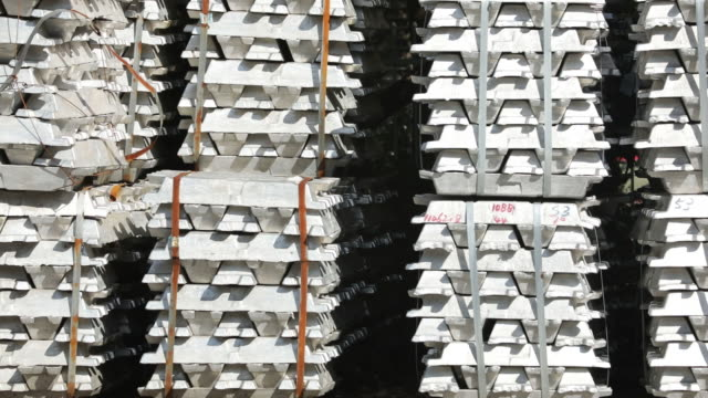 stockvideo's en b-roll-footage met stacks of aluminum ingots sit in a china national materials storage and transportation corporation logistics center in wuxi china on thursday august... - aluminium