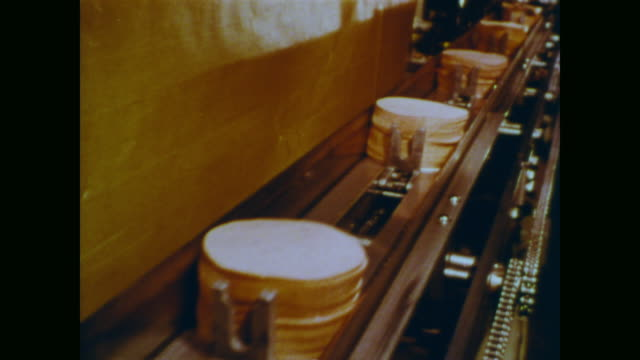 1966 stacks of bologna lunchmeat travel down a conveyor belt - documentary footage stock videos & royalty-free footage