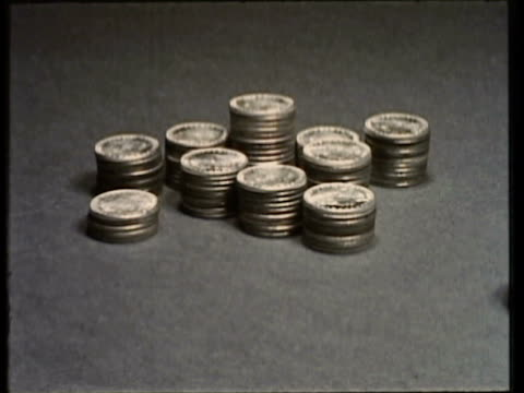 1955 cu stacks of coins piling up on desk / usa - stack stock videos & royalty-free footage