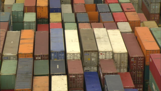 WS HA Stacks of colorful shipping containers piled on top of each other in freight yard / Basel, Switzerland
