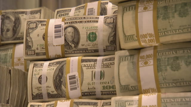 CU Stacks of labeled 100 dollar bills in bundles of $10,000 each / Kansas City, Kansas, United States