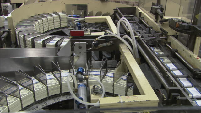 ms stacks of money moving through a conveyor belt system / washington, district of columbia, united states - money press stock videos and b-roll footage