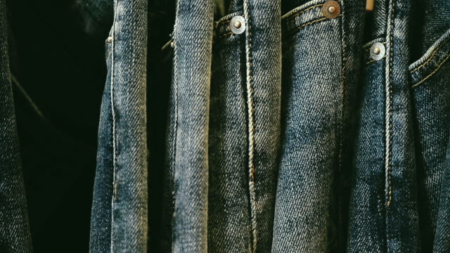 Stacks Of New Blue Jeans In The Store