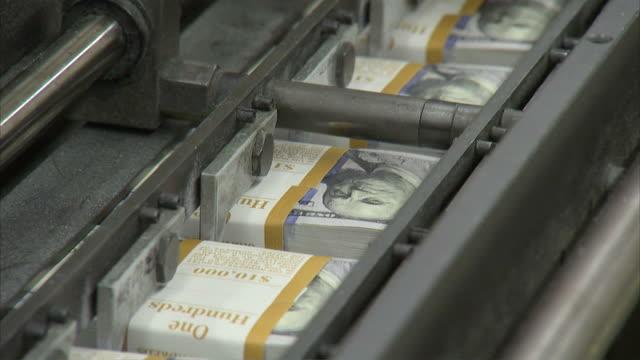 cu stacks of one hundred dollar bills moving along conveyor belt / washington d.c., washington d.c., united states - money press stock videos & royalty-free footage