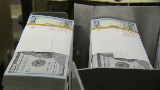 cu stacks of one hundred dollar bills moving along conveyor belt / washington d.c., washington d.c., united states - bundle stock videos & royalty-free footage