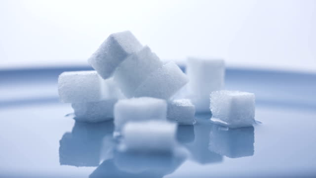 t/l stacks of sugarcubes dissolving in water - plaque bacteria stock videos & royalty-free footage