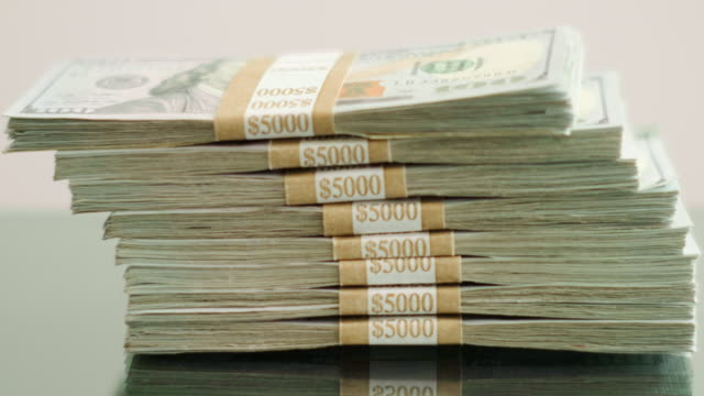 stacks of us currency 100 dollar bills - stack stock videos & royalty-free footage