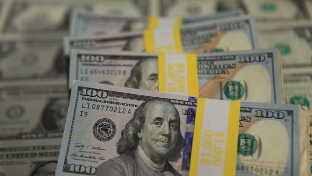 stacks of us currency are arranged for a photograph in washington dc us on tuesday feb 25 five stacks of $100 bills on top of a sheet of uncut us $1... - benjamin franklin stock videos and b-roll footage