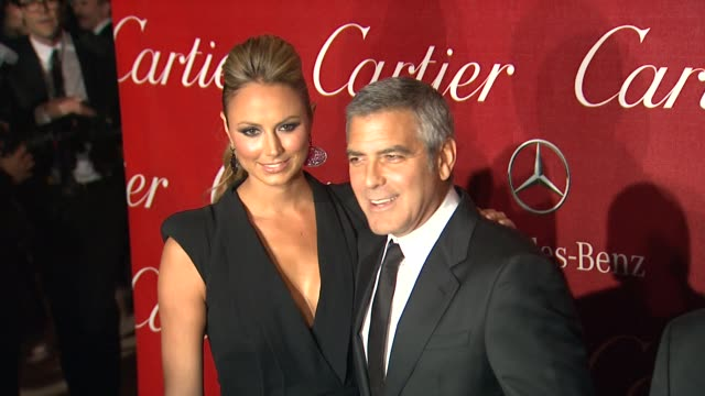 stacy keibler and george clooney at the 23rd annual palm springs international film festival awards gala on 1/7/2012 in palm springs ca - george clooney stock videos and b-roll footage
