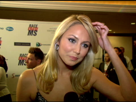 Stacy Keibler on why shes at the event the disco theme at the 13th Annual Race to Erase MS red carpet at Hyatt Regency Century Plaza in Century City...