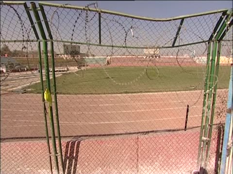 stadium formerly used for public executions under taliban rule - law stock videos & royalty-free footage