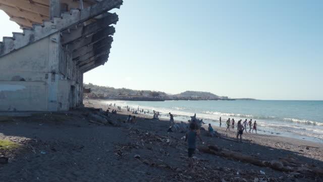 stockvideo's en b-roll-footage met stadium in a beach in a bizarre location. - schaduwe