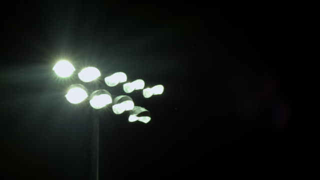 ms stadium lights switch off/on / riverside, california, united states  - turning on or off stock videos & royalty-free footage