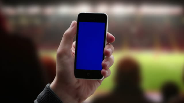 stadium phone message. iphone chromakey screen. - gambling stock videos & royalty-free footage