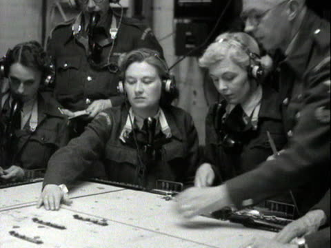staff at a royal air force operations centre plot the course of aircraft during a military training exercise - royal air force video stock e b–roll