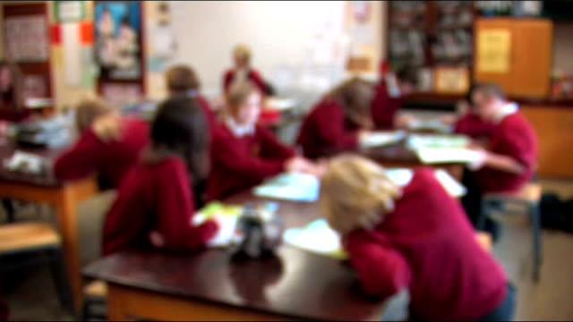 vídeos y material grabado en eventos de stock de staff at lancashire secondary school strike over lack of discipline cambridgeshire ely ext sign on building 'city of ely community college' long shot... - pasillo de entrada
