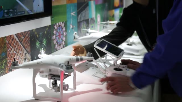 Staff demonstrate the DJI Phantom 3 Professional a drone manufactured by SZ DJI Technology Coat the booth of the CP Camera and Photo Imaging Show in...