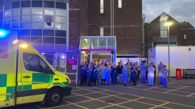 nhs staff from dorset county hospital applaud at the entrance of the emergency department on april 02 2020 in dorchester united kingdom the clap for... - nhs stock-videos und b-roll-filmmaterial