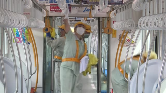 staff from japan's seibu raiway disinfect trains with a wipe down at its vehicle base in saitama prefecture - saitama prefecture stock videos & royalty-free footage