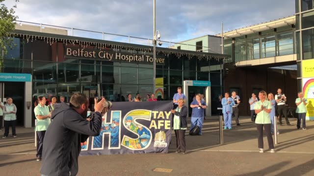 staff gather outside the nightingale hospital in south belfast, as they join in the applause to salute local heroes during the nationwide clap for... - belfast stock videos & royalty-free footage