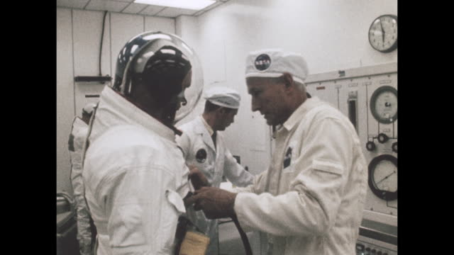 vídeos de stock e filmes b-roll de staff help astronauts prepare from departure for the apollo 11 launch, the first manned space craft due to land and walk on the moon from the kennedy... - prt