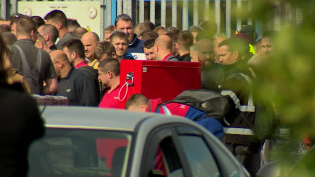 staff leave the wrightbus factory in ballymena northern ireland as the bus maker goes into administration - unemployment stock videos & royalty-free footage