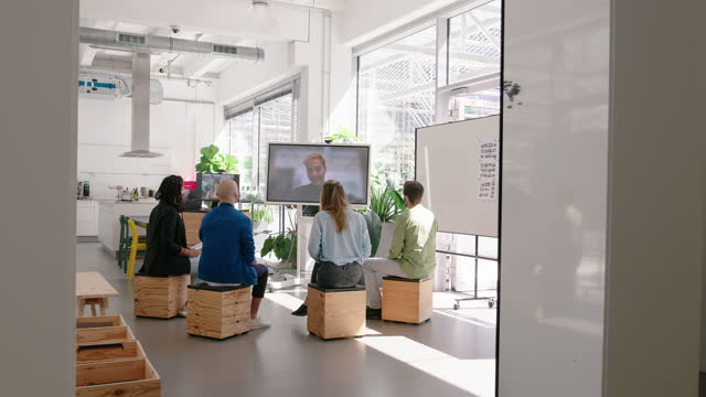 staff meeting in hybrid office space via video call - development stock videos & royalty-free footage