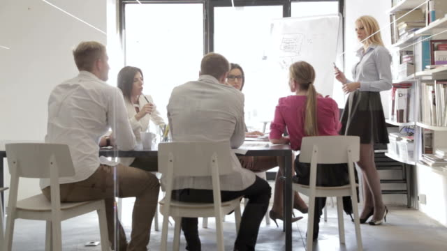 Staff meeting leading by woman