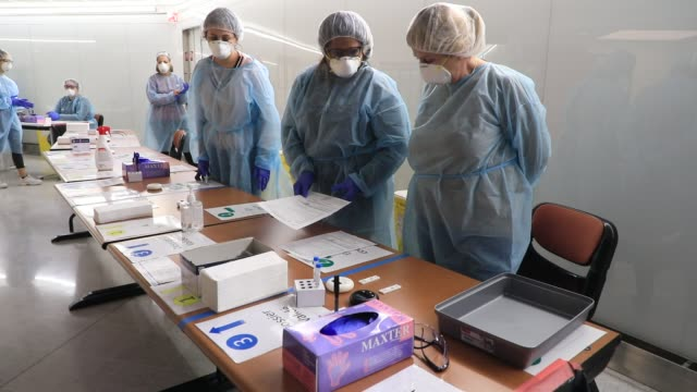 staff member at work during the installation of antigenic tests in french airports to detect travelers carrying covid-19 on november 6, 2020 in orly,... - medical examination stock videos & royalty-free footage