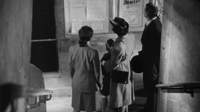 1948 montage a staff member giving the new family a tour at the pioneer health centre in peckham / london, england - peckham health centre stock videos & royalty-free footage