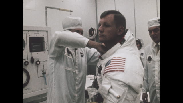 vídeos de stock e filmes b-roll de staff members help astronaut prepare for apollo 11 departure, the first manned space craft due to land and walk on the moon from the kennedy space... - prt