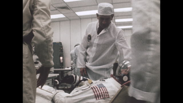 vídeos de stock e filmes b-roll de staff members help astronauts prepare for departure for the apollo-11 launch, the first manned space craft due to land and walk on the moon from the... - prt