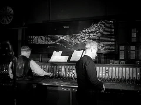 staff monitor the arrival and departure of trains from a control panel in the signal box at waterloo station. - signal box stock videos & royalty-free footage