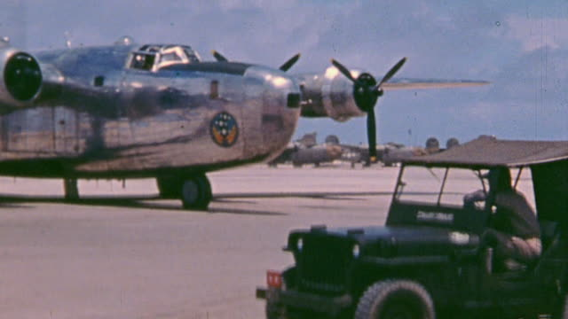 staff officers shaking hands with base staff and boarding a b24 liberator and the bomber taxiing for takeoff - esplosivo video stock e b–roll