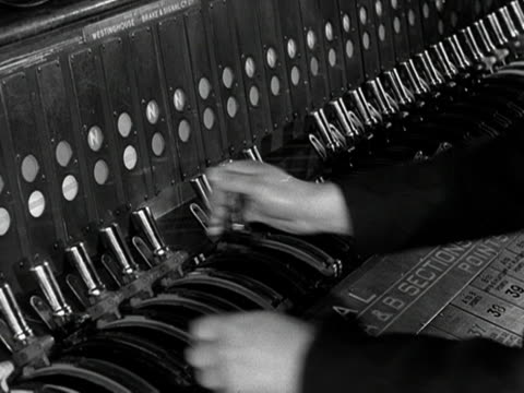 staff operate levers on a control panel in the signal box at waterloo station. - signal box stock videos & royalty-free footage