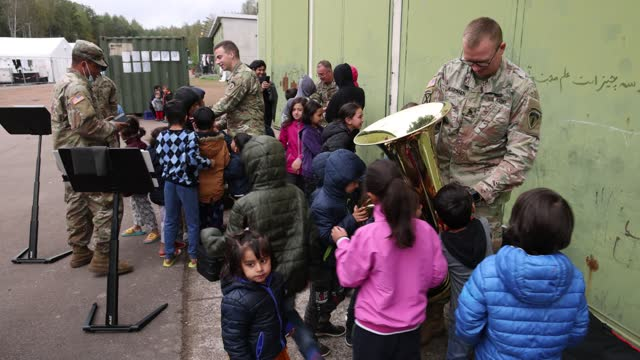 staff sergeant william karsten of the u.s. army europe and africa brass quintet lets afghan children handle his tuba after peforming for afghan... - us military stock videos & royalty-free footage