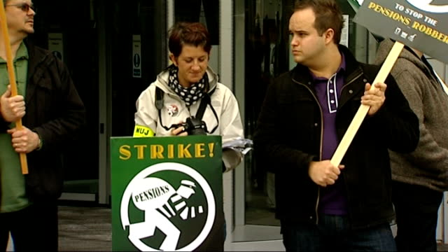 vídeos de stock, filmes e b-roll de bbc staff take industrial action over pensions general views picket line at white city striking bbc employees with placards 'strike to stop the... - stop placa em inglês