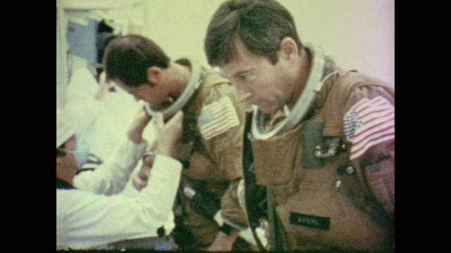 nasa staff test dress check and prep the astronauts for their flight before closing them inside the shuttle - 1981 stock videos & royalty-free footage